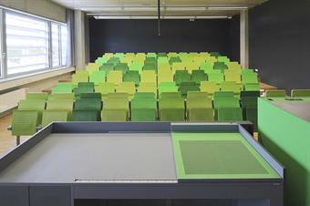 Lecturehall with green chairs