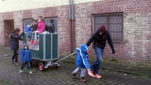 Students and children towing the Mobile School trailer